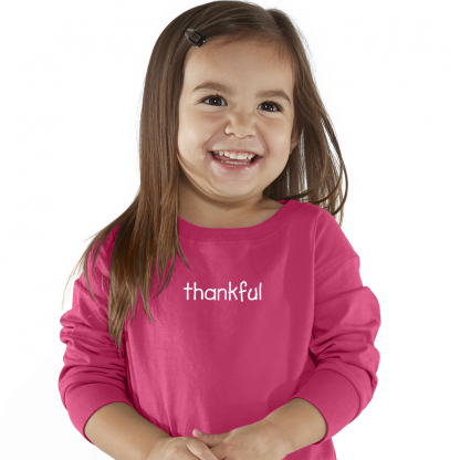 Toddler Girl waring long sleeve T-Shirt with a positive thankful word